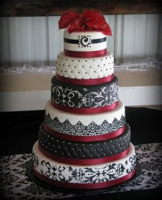 Burgundy, Black  and White wedding. These are my wedding colors, except it will be Crimson and Cream. :)