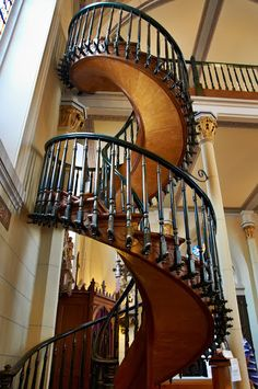 Loretto Chapel, Santa Fe, New Mexico. The staircase has two 360 degree turns and no visible means of support. Also, the staircase was built without nails—only wooden pegs. Photo by Andy New.