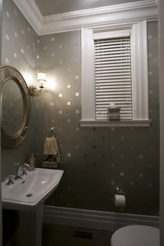 Stencil squares with metallic paint for a bit of sparkle! Great to make a small powder room seem bigger!