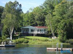 Chalet Maison à vendre  bord de l'eau Lac à la Perchaude St-Tite Mauricie Usagé à vendre à St-Tite - LesPac.com Immobilier St-Tite