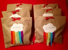 Here's how to make some cute rainbow theme party bags which cost very little and are easy to make.  We loved  and decided to make mini ones for our party bags.