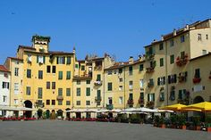 Lucca - The Piazza Anfiteatro, a circle of medieval apartments built onto the foundations of a Roman amphitheatre in Lucca