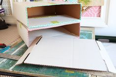 Clever and budget friendly idea and step-by-step tutorial showing you how you can make a stackable scrapbook paper organizer out of a cardboard box | In My Own Style