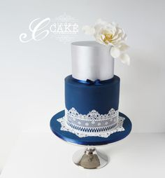 Navy and silver lace wedding cake. - Cake by cindyscakecreations