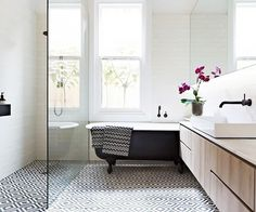 """""""The owners love bold geometrics, so we wanted something strong and eye-catching, without being loud or overly colourful. A bold tile, like a rug, makes the floor the focal point,"""" interior..."""