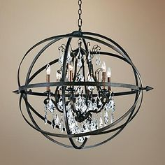 This unique, contemporary chandelier combines two distinct elements: hand-worked wrought iron and shimmering glass crystal pendants. The effect is stunning.