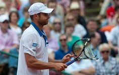 Andy Roddick holds his broken racquet in Dusseldorf.
