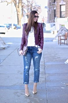 Fringe top, ripped jeans, metallic heels and burgundy leather jacket