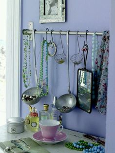 Jewelry holder. I like the hanging ladles to hold small, loose jewlery