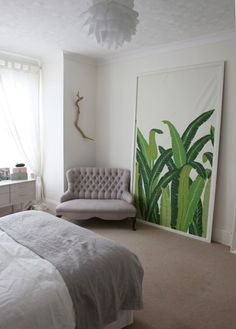 For a less permanent plant print idea, consider framing fabric or wallpaper for a dramatic art piece.