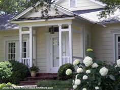 The unique column design of this small porch help it to stand out and emphasize the front door. Front-Porch-Ideas-and-More.com #porch
