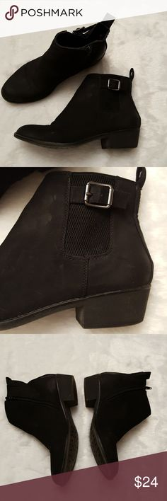 Black Ankle Booties Suede feel All man made materials Zips up on inside of foot Short 1.5 inch heel They are still in great shape some minor wear marks White Mountain Shoes Ankle Boots & Booties