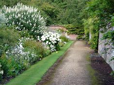 The White Border Garden, which leads from the Monks' Garden to the Secret Garden, includes white hydrangeas, roses, agapanthus, and ornamental pears.