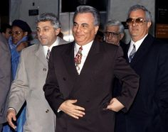 John Gotti (c.) with a smile on his face, older brother Peter Gotti (r.) and John (Jackie Nose) D'Amico leave Manhattan Supreme Court where he was on trial on charges of conspiracy and assault in the 1986 shooting of a carpenter's union official.