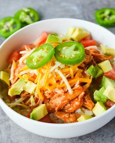 This Keto Chicken Enchilada Bowl is a low carb twist on a Mexican favorite! It's SO easy to make, totally filling and ridiculously yummy!