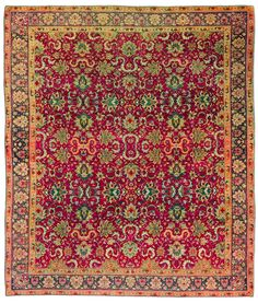 A Turkish Hereke rug BB3567 - by Doris Leslie Blau. An antique early 20th century Turkish rug, the rich crimson field with an allover trellis of palmettes, cloudbands ...