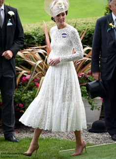 Duchess Kate dons Dolce & Gabbana for Royal Ascot debut.  The Duchess chose her white Dolce & Gabbana Cotton-Blend Lace Dress. The midi-length white dress is an intricate piece with a nipped in waist and tiered swishy skirt. It's available at Net-A-Porter discounted from £5,995 to $3,597. Shoes are suede Gianvito Rossi in praline.