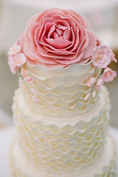 Ruffle and roses cake. Simple and really, really cute. If not for a wedding, then maybe for a tea party? A fancy tea party. So cute though.
