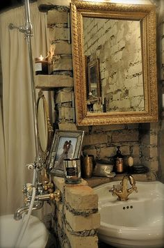 raw brick + gold bathroom.