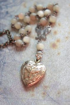 Vintage military heart locket with vintage mother of pearl beads necklace by frenchfeatherdesigns on etsy.