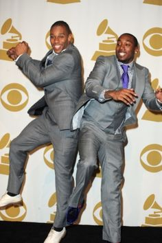Super Bowl champs Victor Cruz and Mario Manningham of the New York Giants hit the red carpet ...and yes he did the salsa at the Grammies  Cruuuuuz!