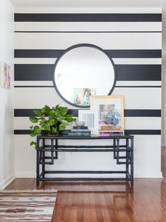 I could see doing a small version of painted stripes just in entry w a mirror as well. Striped Entryway