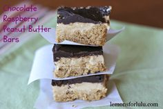 A peanut butter cooke is the  crust for these easy peanut butter bars.  Their is a creamy peanut butter filling and a raspberry  infused chocolate frosting!  Peanut, butter and dessert! lemonsforlulu.com
