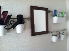 Bathroom - Ikea Fintorp wall hangings and containers (found in kitchen section). Cheap and easy!