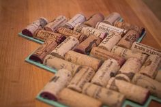 These are super easy and fast to make. Using a serrated knife, cut wine corks lengthwise. Uh. Do not attempt this during or immediately after drinking the wine. Hot glue the halved corks into a her...