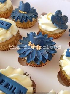 Blue and gold dresses and flowers birthday cupcakes.
