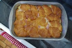 Ham & Swiss croissant bake.  I have made a version of this and everyone always LOVES it!  I do not use vanilla, instead add 1/2 tsp. cayenne pepper (or Paprika if you do not like a little spice) to egg mixture and pour over open croissant halves.  I then put croissant tops on, cover and refrigerate overnight and bake the next morning.  Yummy!  <3 D