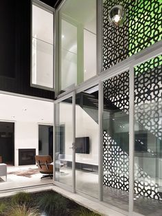 architectural screen spanning between floor + ceiling acts as a guardrail and define spaces.