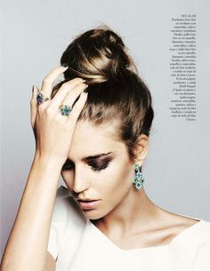 theglitterguide:  high bun + statement earrings