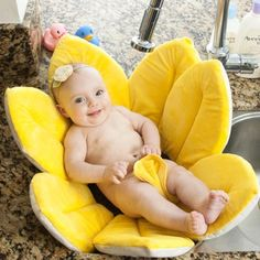 Babies...precious and sweet. Their smiles makes me smile. Love this Blooming Bath that this cute little darlin is in too:)