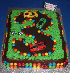 Idea for Caleb's birthday cake this year- He loves the car movie. So easy..cake, chocolate icing, oreo cookie crumbs, smarties and some green icing!