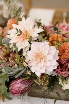 Autumn centerpiece for foodies that featured fennel, artichoke, eggplant, figs, persimmons, and dahlias. Grown and designed by Love 'n Fresh Flowers.  Photo by Maria Mack Photography.