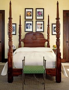 framed pictures around the headboard......