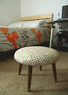 Footstool reupholstered with Orla Kiely laundry bag