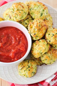 Cheesy Zucchini Tots - these tots are loaded with shredded zucchini, bread crumbs, and cheese!! It makes for the perfect appetizer served with marinara sauce, or use it as a side dish!