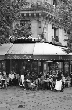 Pedestrian rest at Les Deux Magots, Paris, France. To Do: Order something small and strong from the menu, show off legs from under a short skirt, people watch like crazy, write a postcard to loved ones.