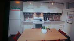 Note high cabinets, also this small space has everything needed in a kitchen on one wall.