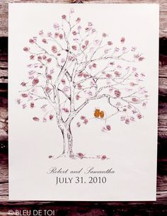 Guestbook fingerprint tree. Cute with the bride and groom in a different color.