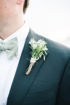 #boutonniere #green Photography by brklynview.com,  Floral Design by spinanyc.com  Read more - http://www.stylemepretty.com/2013/08/28/lighthouse-at-chelsea-piers-wedding-from-brklyn-view-photography/