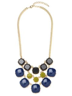 Make a grand statement with this three-tiered bib necklace. It features gobstopper-sized baubles, in various shades of blue and green, all set against a glistening gold-link chain.