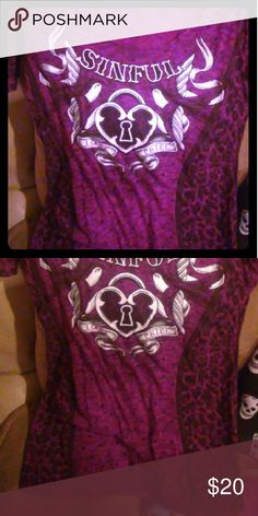Sexy leopard tee This fun sinful tee is in great condition. I've worn it a couple times. Smoke free home. Its purple and black. Sinful Tops Tees - Short Sleeve