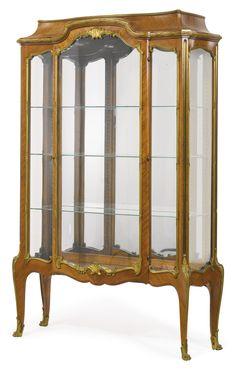 Paul-Charles Sormani b. 1848 -  A Louis XV style gilt-bronze mounted kingwood vitrine. Paris, last quarter 19th century