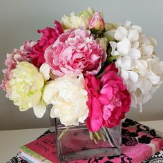 This arrangement is playful with a bright pink peonies, white and pink hydrangea, pink roses and vibrant green and white flowers. It is made with high quality silk flowers that look freshly picked. Di
