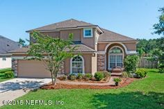 PERFECT for entertaining with its open spaces, two story soaring vaulted ceilings and abundance of large windows.  It fe