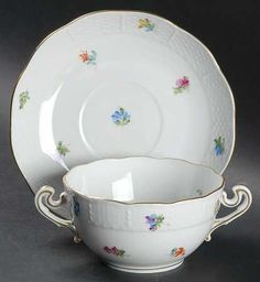 """Kimberly"" china pattern with rainbow multicolored floral accents from Herend."