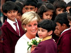 June 6, 1997: Diana, Princess of Wales embraced children when she visited the Shri Swaminarayan Mandir Hindu Temple in Neasden, London.